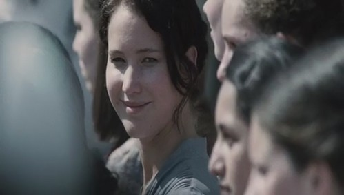 Who is Katniss looking and smiling at?