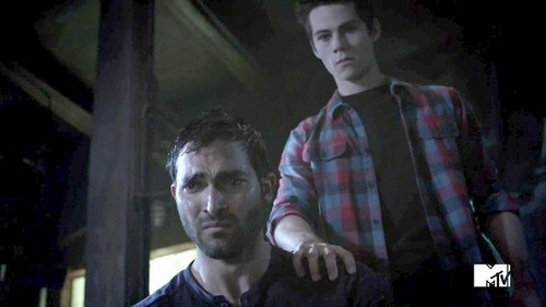Who are Stiles and Derek watching in this scene