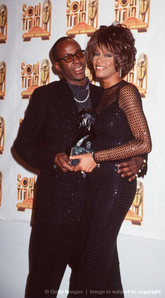 What year did Whitney Houston marry Bobby Brown
