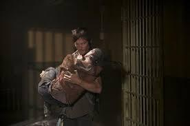 When the surviving group welcome Carol back, after Daryl found her alive, does he embrace her afterward with a kiss?