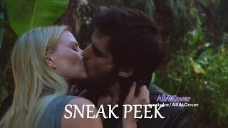 Who initiated the kiss between Hook and Emma?