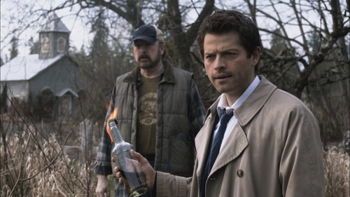 Who does Castiel hit with the molotov cocktail?