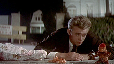 True or False: The opening scene in the movie with Jim and the toy monkey was improvised sa pamamagitan ng James Dean.
