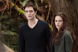 Who does Edward save from getting hit by a фургон, ван in the first Twilight movie?