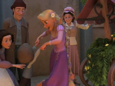 What's the name of the little boy Rapunzel took to dance in Tangled?