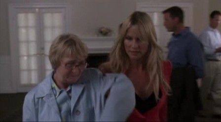 What is Edie telling Karen not to touch, while trying to get her out of her open house at Paul's?