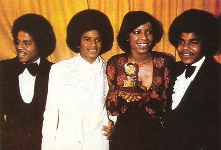 Who is this lady in the photograph with the Jacksons