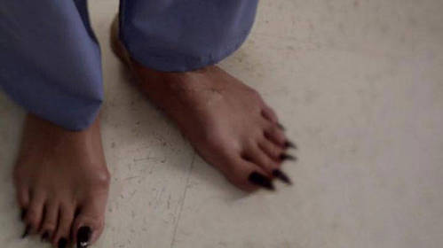 Who's feet are these in this scene