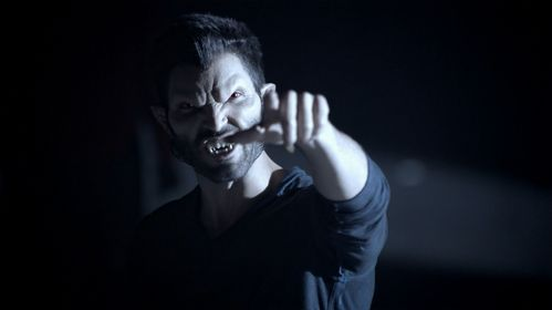 Who is Derek pointing at in this scene