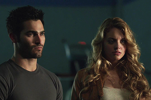 Who are Derek and Erica looking at in this scene.