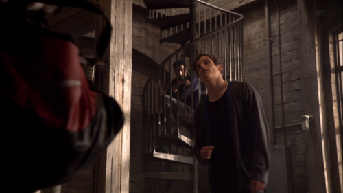 Who are Derek and Isaac looking at in this scene.