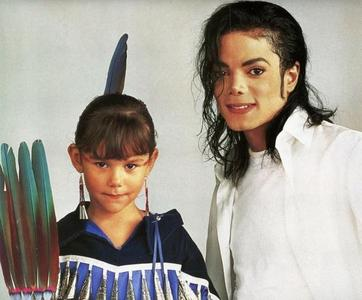 Who is the girl in the photograph with Michael?