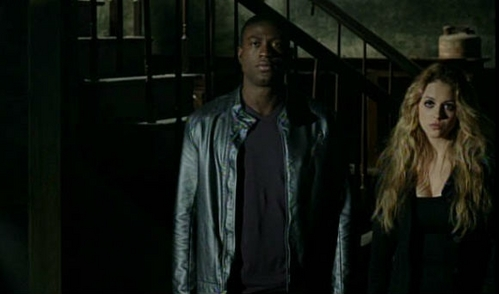 Who are Boyd and Erica looking at in this scene.