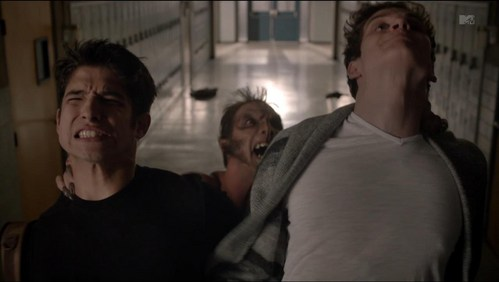 Who picked up Scott and Isaac from the back of their necks in this scene.