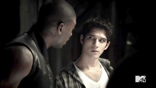 Who is Scott looking at in this scene.