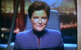 In what movie did Captain Janeway appear as an Admiral for a TNG Movie.