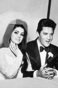 What year did Elvis marry longtime girlfriend, Priscilla Beaulieu