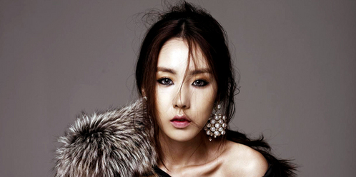 When did Kan Mi Youn debut as a soloist?