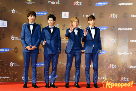 Which Korean entertainment company is CNBLUE under?