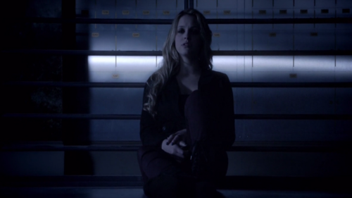 Who is Erica talking to in this scene.