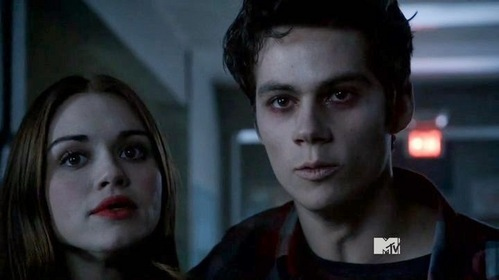 Who are Lydia and Stiles looking at in this scene.