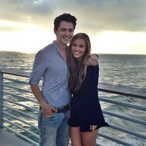As of July 2014, what is the name of (former member) Damian McGinty's girlfriend?