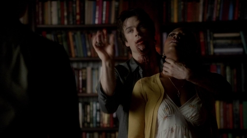 Who is the woman Damon is holding?