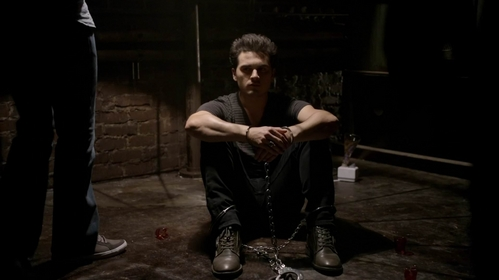 Why is Enzo chained?