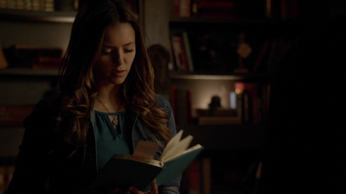 What is Elena reading?