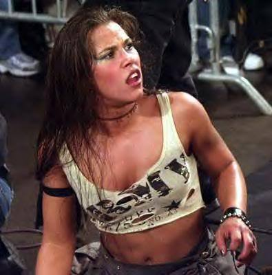 What was the name of the stable Mickie James was a part of in TNA before signing with the WWE?