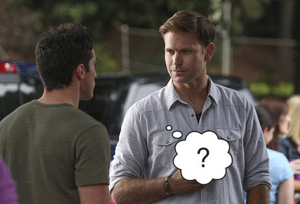 What color cup was Alaric holding at the party?