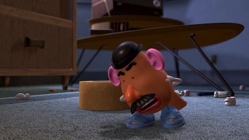 Toy Story 2: What does Mr. Potato Head attach to his eye sockets during this scene?