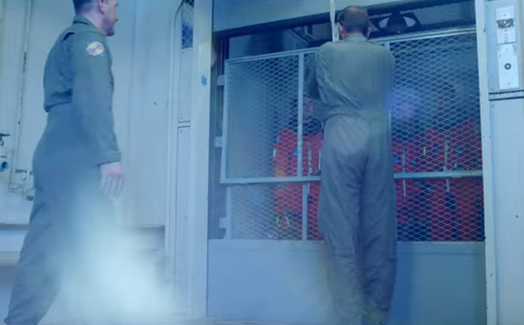Who's the first to get inside the elevator in the DMD video?