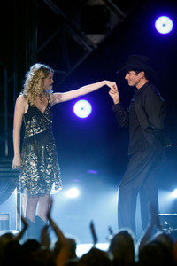 At the 2009 CMA awards, magician David Copperfield performed two illusions on Taylor. In the first,  he made her appear inside an empty elevator. What was the second one?