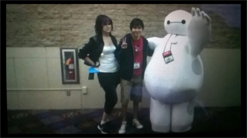 Which Big Hero 6 character is my best friend Cosplaying as? Hint he is the skinny guy in the middle of the picture.