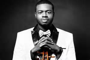 How old is Kevin Olusola