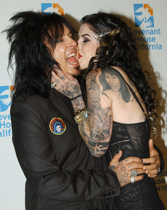 She dated _________ bassist Nikki Sixx ?