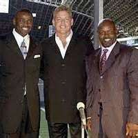 When were The Triplets inducted in the Dallas Cowboys Ring of Honor?