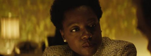 The mid-credit scene features Amanda Waller and ?