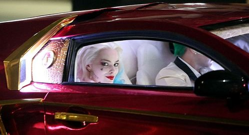 The Joker's car is a customized ?