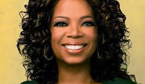How much is Oprah's net worth according to Forbes?