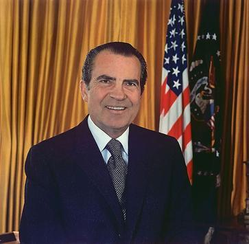 Who portrayed Richard Milhous Nixon in the 1995 film biopic