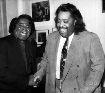 Who is this man in photograph with James Brown