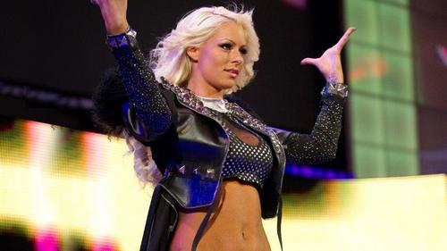 To whom Diva did Maryse get her First Championship?