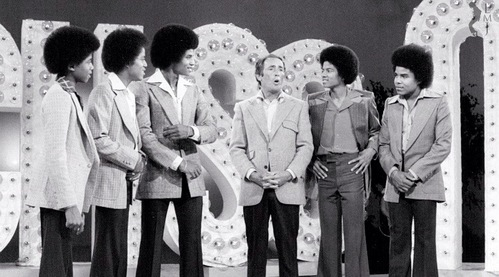 Who is this man in the photograph with the Jacksons
