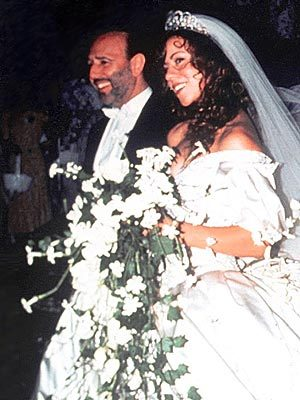 What year did  Mariah Carey and Tommy Mottola exchanged vows