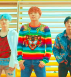 What brand is J-Hope's arco iris, arco-íris sweater in the DNA mv?