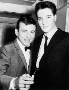 Who is this man in the photograph with Elvis Presley