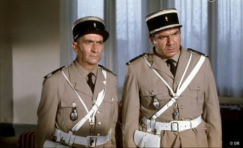 Louis de Funès(L)has played a lead role on a French comedy franchise The Troops Of St. Tropez(Le Gendarme De Saint-Tropez in French).What was the name of his character?