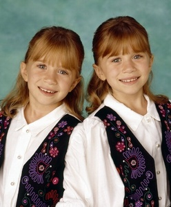 How old were Mary-Kate and Ashley when they became millionaires?